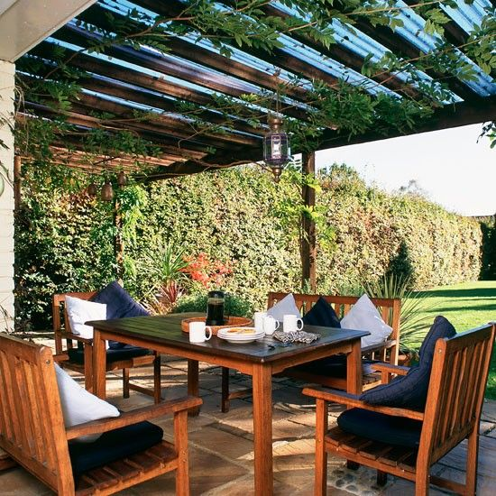 A sheltered alfresco dining area is great for year-round entertaining. The addition of plenty of cushions on wooden benches creates a relaxed and informal feel.  Read more at http://www.housetohome.co.uk/room-idea/picture/garden-decking-and-patio-ideas-10-of-the-best/2#KvOld5qoGESOuPB6.99