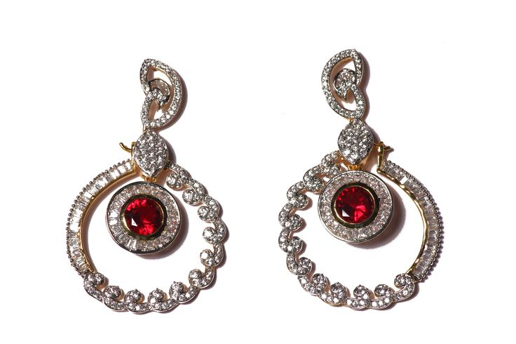 Exclusive Red American Diamond Costume Earring -These earrings can be worn as a long dangler, and also loops. The earring can be detached to make two earrings, additionally multi colored stones are given with the set to change the colors of the stone as per your choice.