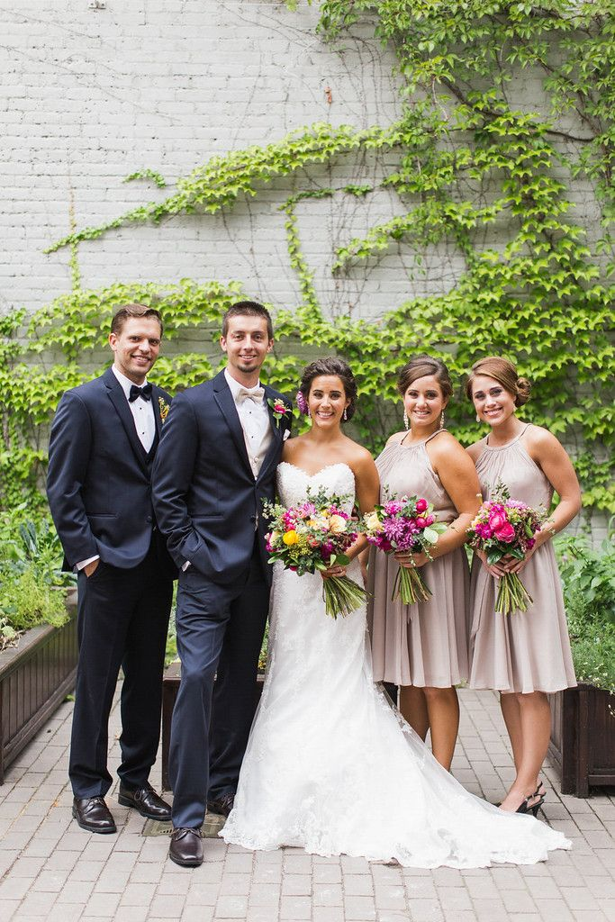 Dark charcoal suits with neutral, latte bridesmaid dresses | Floral Graffiti Inspiration at The Big Fake Wedding