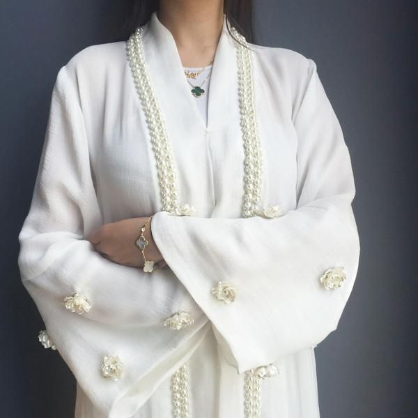 Beautiful Linen White abaya Robe with French lace and pearls detailing. White rosettes on the sleeve. Length 58inches.