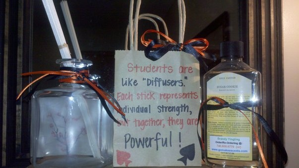 """Makes a great Teachers Gift!!! Order your diffuser/scent (micro fiber reeds). Wrap ribbon around the top- I used my school colors. Put in bag as gift. Bag says: """"Students are like diffusers. Each stick represents individual strength but together they are powerful!"""" www.mygc.com/brandyyingling to place your DIFFUSER order."""