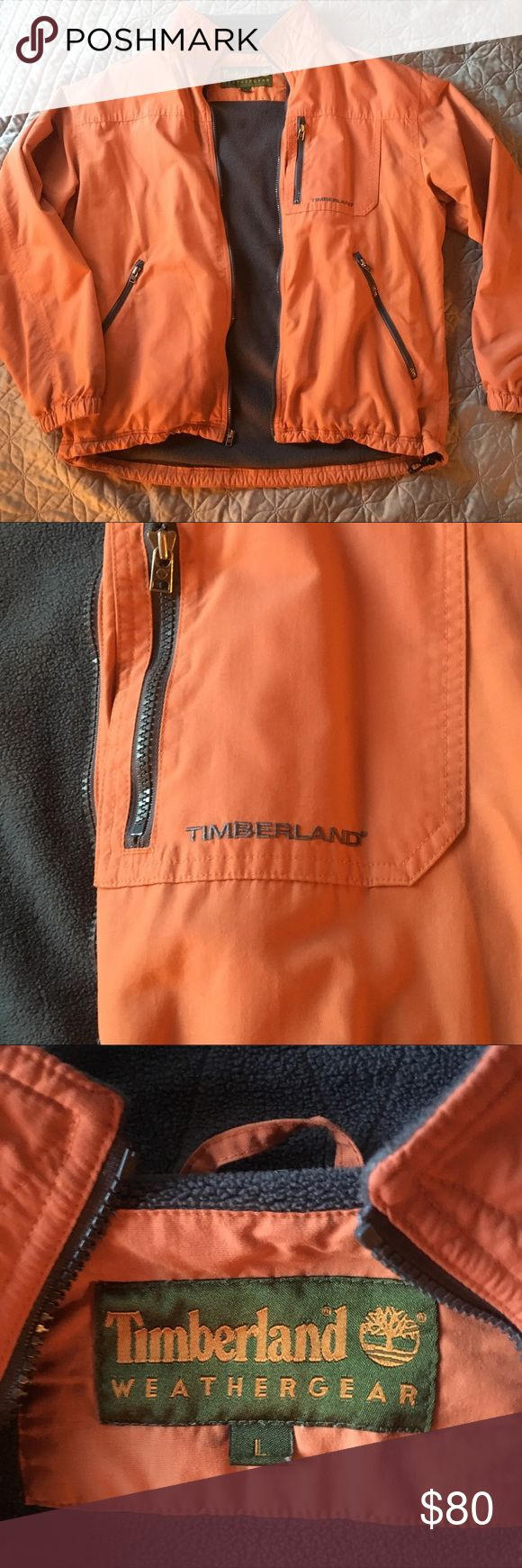 "Timberland Weathergear jacket Men's Timberland weathergear jacket. Orange outer with dark grey fleece inside. 3 front zipper pockets - one on left breast. Adjustable waist. In perfect condition. No picture of inside material tag - it is faded and just white.   Measurements are approximate lying flat.  Sleeve 25"" Shoulder to hem 27"" Armpit to armpit 25"" Timberland Jackets & Coats"