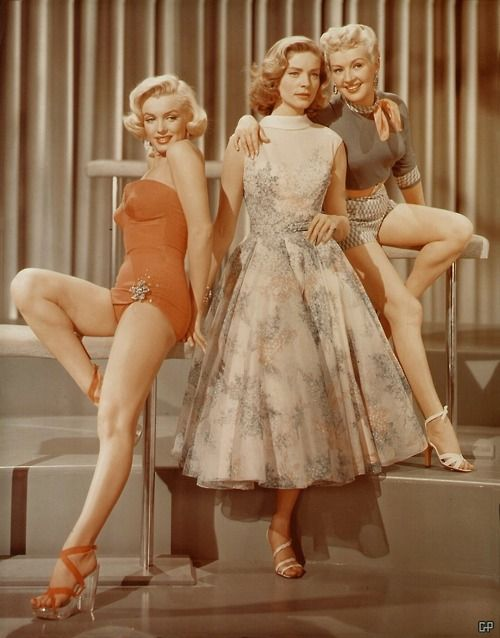 Marilyn Monroe, Lauren Bacall & Betty Grable  On the set of How To Marry a Millionaire circa 1953. (That's what you call one of them there trifectas)