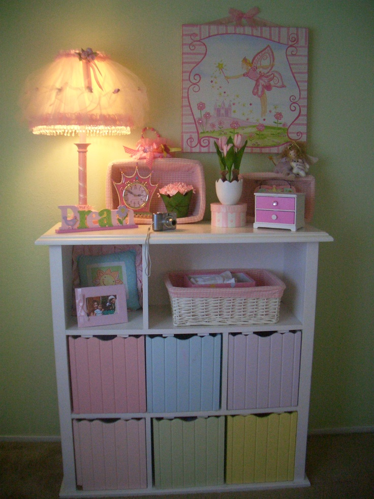 Great idea to store baby odds and ends like bibs, burp rags, receiving blankets, socks, headbands, etc.   I have a shelf similar to this for Miss L's room. I need to find the perfect size baskets for it now.. Ashley