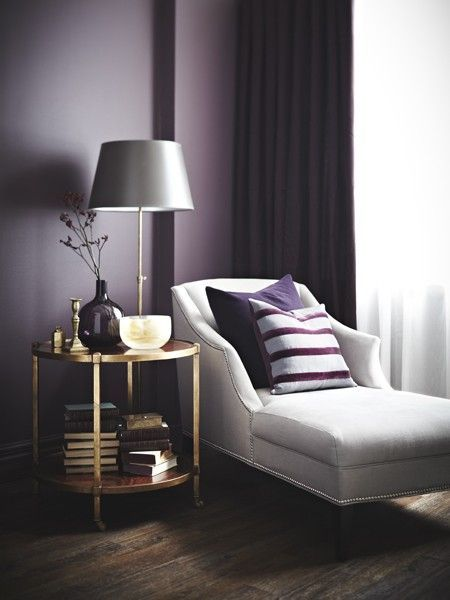 Extending purple from wall to drapes creates sumptuous cocooning effect. Incorporate grey linen chaise by layering w/ solid & striped plum velvet pillows & paint paper shad in complementary soft grey.