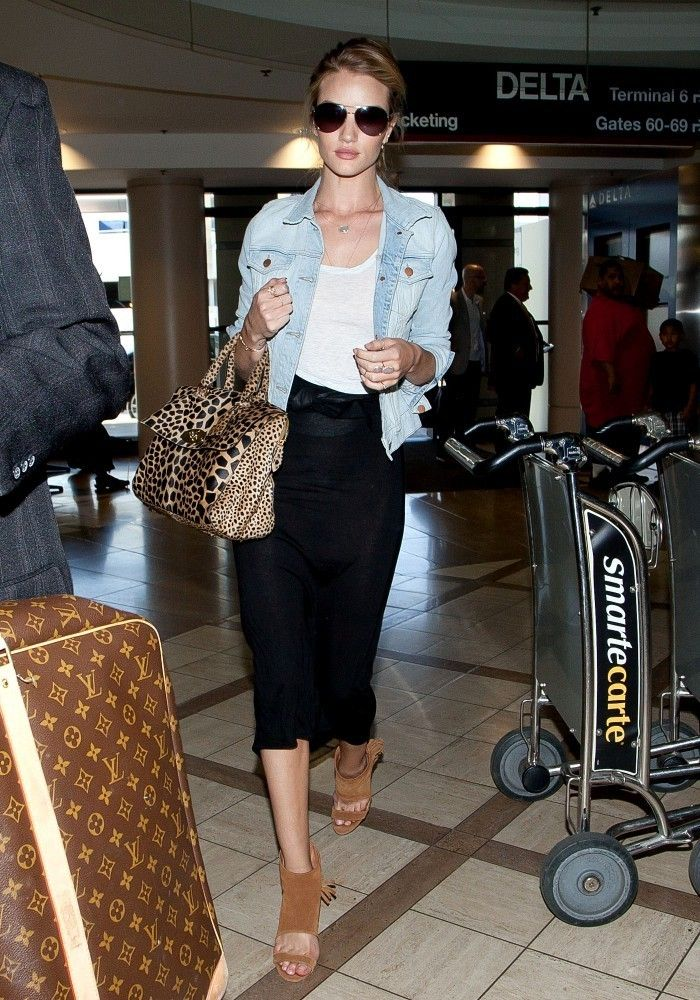 Rosie Huntington Whiteley carries a leopard handbag prepares to depart at LAX (Los Angeles International Airport).
