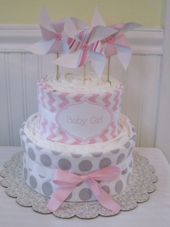 The recipe for the perfect gift! This adorable and modern 2 tier diaper cake is great for any new mom, or mom-to-be. Also makes a delightful table