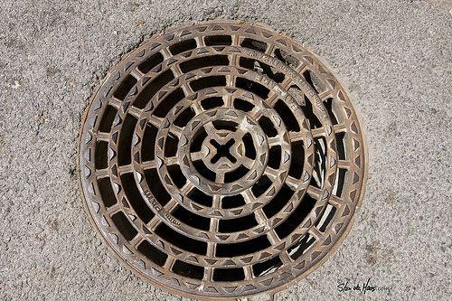 Manhole - Frankrijk, St-Tropez, manhole, manhole cover, stan de haas, kanaldeckel, gullydeckel, asphalt, background, circle, city, cover, detail, drain, grate, gray, hole, iron, metal, old, pavement, road, round, sewage, sewer, sidewalk, steel, street, symbol, underground, urban, water, putdeksel  http://www.standehaas.com  https://www.facebook.com/pages/Stan-de-Haas-Photography