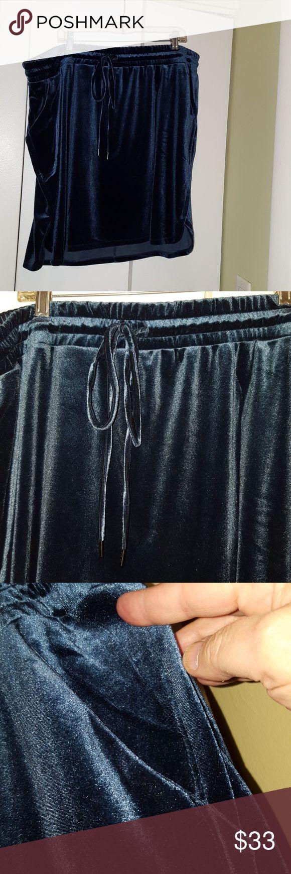 """NWT Velvet Pull-on Skirt Gorgeous teal blue velvet. So soft! Dress up or down. Skirt has smocked, adjustable draw-string waist, side pockets, sirt-tail hem. Length 20"""" from center front. Torrid size 3 (22/24) torrid Skirts Mini"""