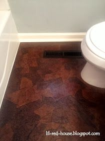 As you may have read in a previous post , I ripped up the ugly flooring in the bathroom only to find another layer of ugly flooring...and t...