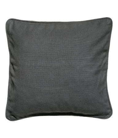 Dusky green. Cushion cover in woven cotton fabric with piping. Concealed zip.