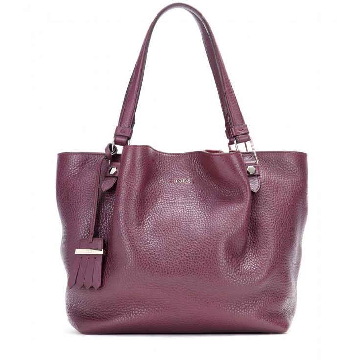 Tod's - Flower Media leather tote - Tod's lives up to its long-standing reputation of fine Italian craftsmanship with this gorgeous tote. Made from tumbled bordeaux leather, it's fully lined and features plenty of pockets for day-to-day organisation. Work the timeless style into your wardrobe now, swinging it by your side next to simple separates. seen @ www.mytheresa.com