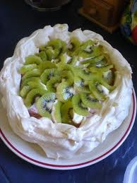 Pavlova! Pavlova is a world famous dessert which was first made in New Zealand. Naturally, pavlova is traditionally topped with kiwi-fruit!
