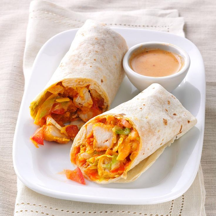 Crispy Buffalo Chicken Wraps Recipe -I'm a busy stay-at-home mom, so I wing it at mealtime. My wraps loaded with Buffalo wing sauce chicken, lettuce and tomatoes are a snap to make. —Christina Addison, Blanchester, OH