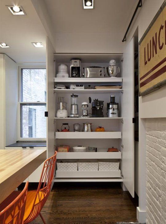 Find another spot for your coffee maker, food blender, and toaster. It will get bulky appliances off the kitchen counter and out of your hair until you need them. Get inspired by this pantry set up from Bunker Workshop, then install your own handmade slide out shelves, with a little help from This Old House.