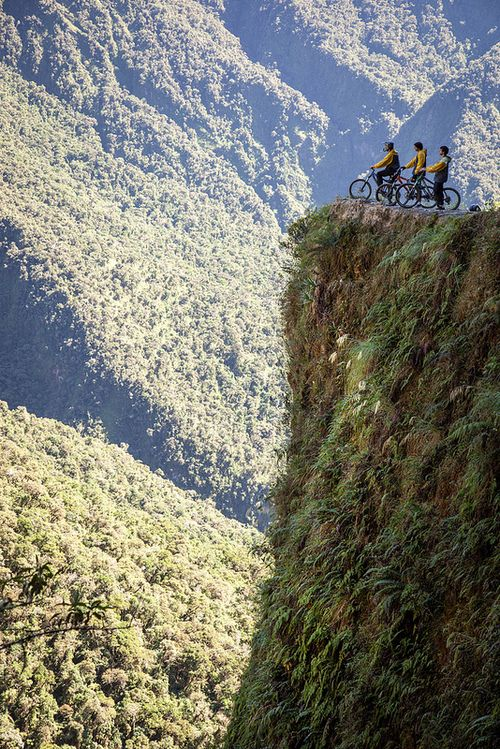 travelthisworld:        Cyclists consider Bolivia's Death Road ♦ Bolivia | by Andrew Waddington