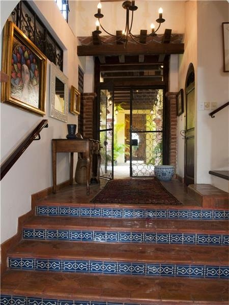 Talavera-tiled risers, clay-tiled steps in hallway