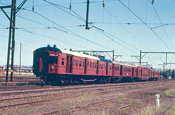 Bradfield power car C3033 leads a down Cowan service at Hornsby January 1972.