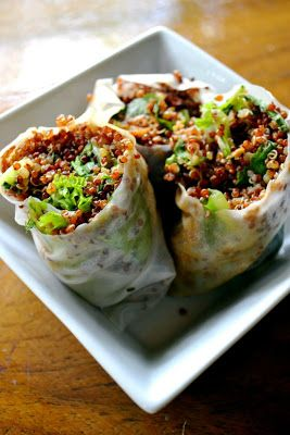 Sesame Quinoa Spring Rolls  2 cups red quinoa   3 cups water   4 handfuls of greens   10 rice paper wrappers   Dressing:   4 Tbs. rice vinegar   5 Tbs. soy sauce   2 tsp. minced garlic   2 Tbs. minced ginger   4 tsp. sesame oil