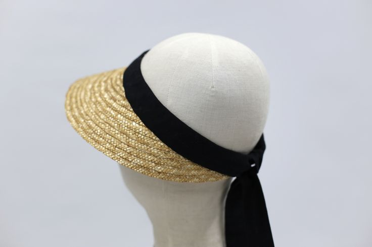 Straw visor from recycled straw and a long cotton ribbon in the back.  #millinery #straw #minimal #fashion #headpiece