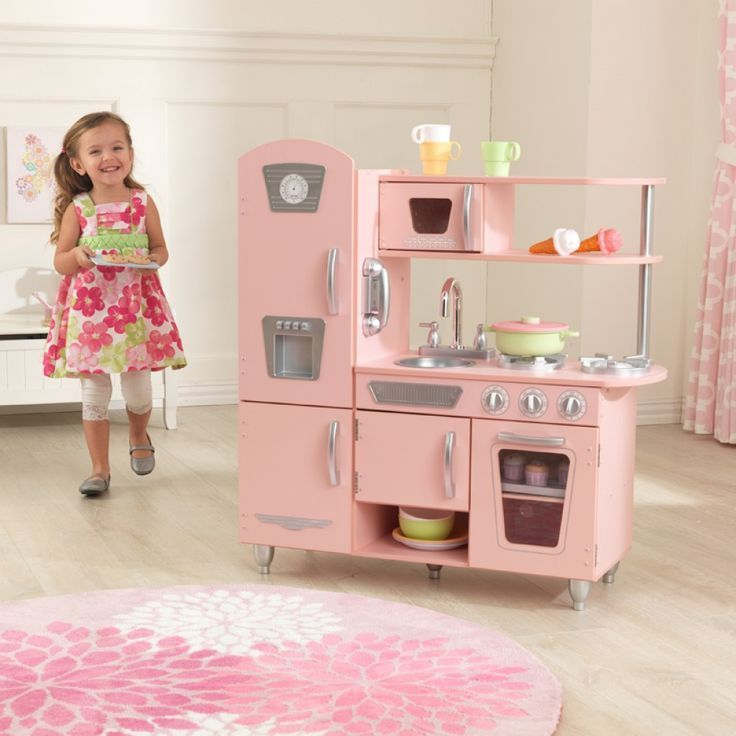 Young chefs are sure to love cooking up fun with our adorable Red Vintage Kitchen! This play kitchen has doors that open and close, knobs that click and turn and tons of convenient storage space. Kids