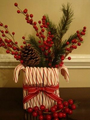 22 best images about craft ideaschristmas centerpieces on for Candy cane holder candle centerpiece