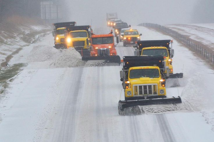 Snow plows and traffic make their way south along Interstate 40 in Durham and Orange county in N.C. on Jan. 22, 2016. Road conditions worsened and power outages increased as a winter storm moved Friday through North Carolina.
