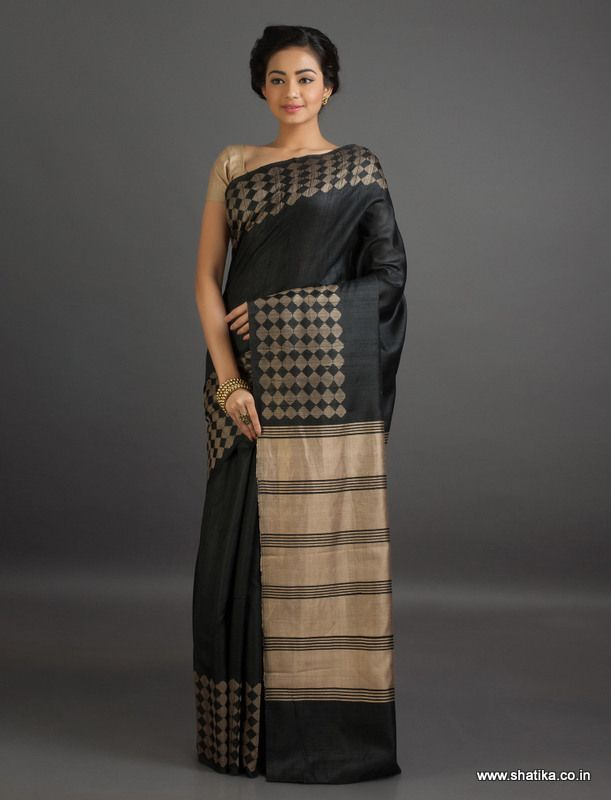 The boldness of black and silken shine of #MatkaSilk is heightened by the glitz of diamonds in gold on the border of the #saree.