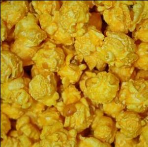 Our freshly popped gourmet White Cheddar & Orange Cheddar Cheese flavored Popcorn is seasoned with our own blend of savory seasonings(maybe a hint of garlic?). Gourmet popcorn with that will make take