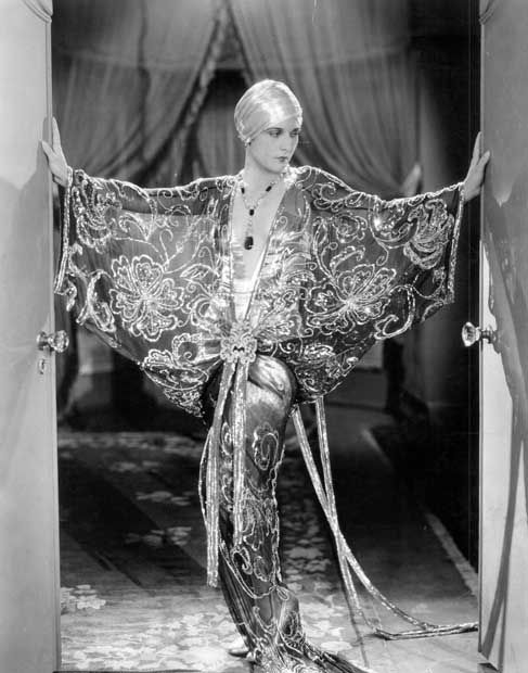 evelyn brent   Evelyn Brent in a butterfly hostess gown of sapphire blue and silver ...