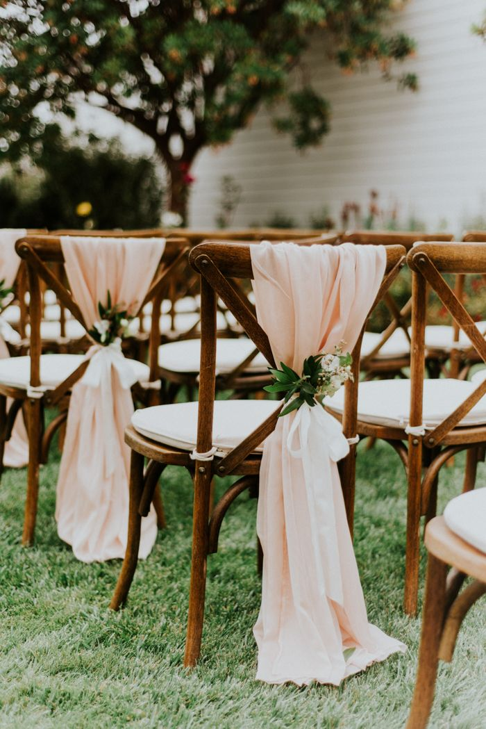 Pink draped chairs from this garden wedding in Cali | Image by Shelly Anderson
