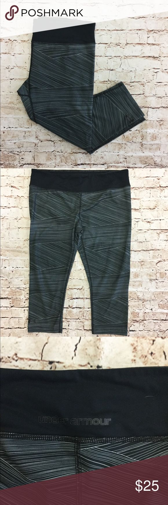 """Under Armour Striped Capri Leggings Black, grey and white capri leggings from Under Armour, size large.  Cannot be modeled. All garments come from a smoke-free home and have no flaws unless stated above. Feel free to ask any questions or make offers!  Approximate Measurements:      Out seam- 27""""     In seam- 18""""     Waist- 16"""" Under Armour Pants Leggings"""
