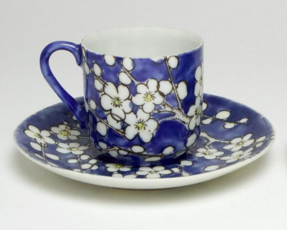 Vintage Chinese eggshell porcelain cup and saucer, hand painted with prunus against a blue background. Both pieces have Chinese four character marks to their bases. The saucer measures approximately 10cm/4inches in diameter and the cup is 4.5cm/1.75inches high. The condition is