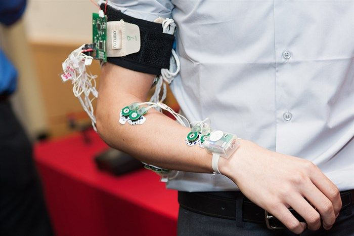 Smart device translates sign language while worn on the wrist - measures inertia (accelerometer, gyroscope) and muscle electrical activity (EMG) to interpret hand gestures. Prototype from R. Jafari, Texas A&M [ American Sign Language, ASL, deaf ]