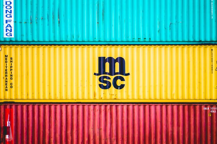 Multi-colored shipping containers of the Mediterranean Shipping Company sit stacked in a container yard in Freeport, Bahamas.  See more #photos at 75central.com #bahamas