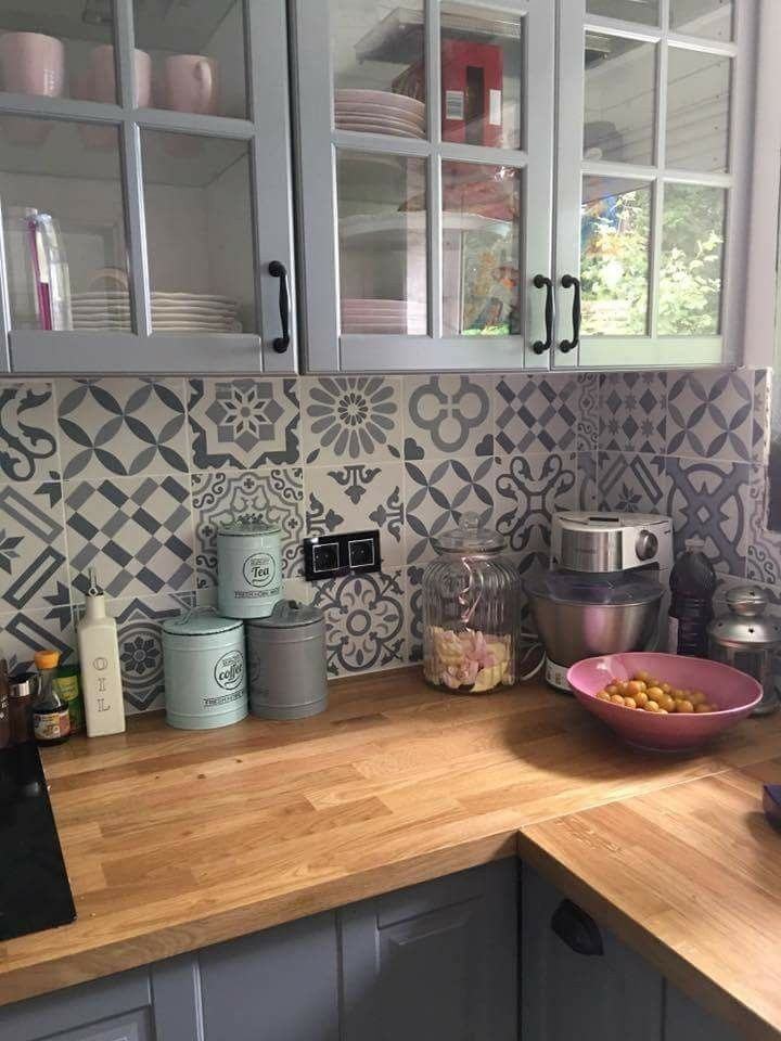 Love the warm wood tones with the two-tone gray and the back tiles with patchwork tiles