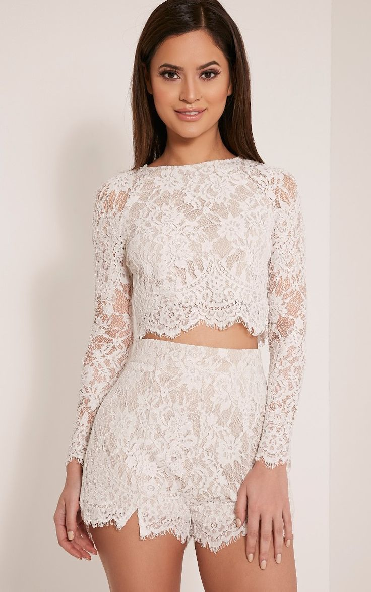 White Lace Long Sleeve Crop TopNail feminine and sultry style in this intricate lace fabric crop ...