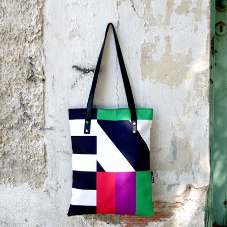 """""""District roads"""" Lines! Horizontal, vertical and diagonals…perfect! They define the whole bag shape. Even with a bold black background there are loud colors for a distinct contrast. The result is a unique and striking design."""