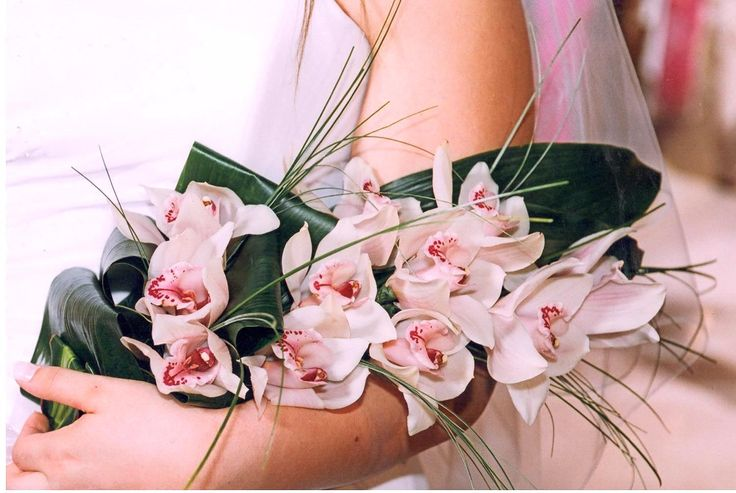 Gorgeous #bridal bouquet with #light pink #orchids