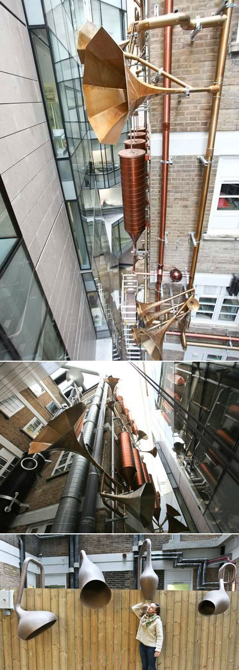 """""""Lullaby Factory"""": Looking like something out of a Dr. Seuss book, this art installation on the side of the Great Ormond Street (children's) Hospital in London plays on the building's Victorian origins by adding """"musical pipes"""" to the existing exterior piping. The narrow space between the two hospital wings is now a fanciful musical instrument, playing lullabies for the young patients. The music is also carried via radio to patients unable to see it in person. 