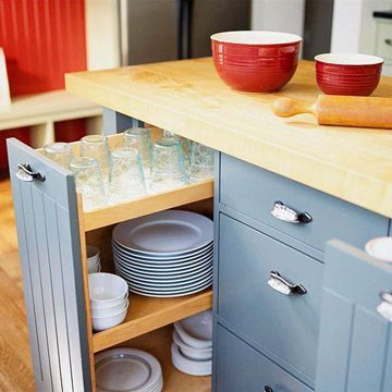 sliding drawer for kitchen storage. Brilliant. Love the blue and style of these cabinets ~ drawers instead of doors any day. This blue would go great with yellow walls. Wood counters are what I want, so these work well.