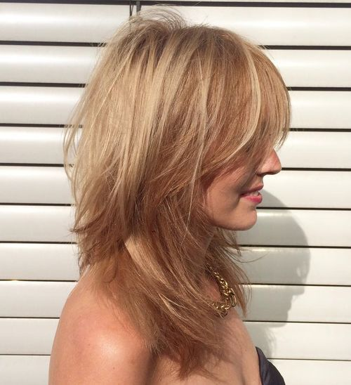 layered tousled blonde hairstyle for straight hair