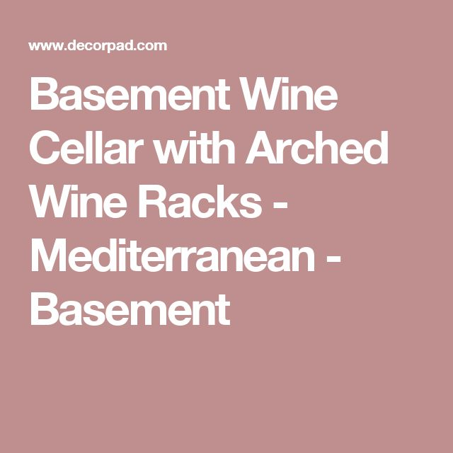 Basement Wine Cellar with Arched Wine Racks - Mediterranean - Basement