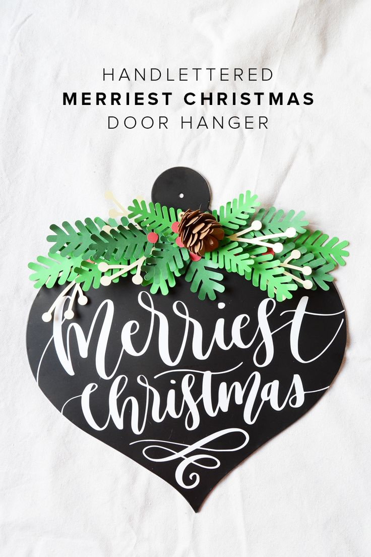 Create a fun, handlettered Merry Christmas Door Hanger and join the giveaway for a chance to win a Silhouette Cameo 3, vinyl and a Craftsy Class from Persia Lou!