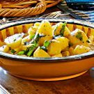 Try the Boiled Potatoes with Parsley Recipe on Williams-Sonoma.com.  Side dish for beef bourguignonne.