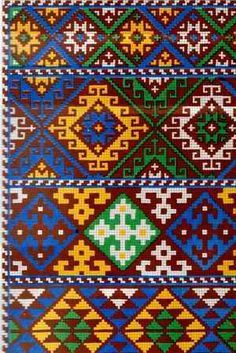 Armenian folk embroidery. Subtlety and skill execution differ Armenian embroidery with their multicolored ornaments, embroidered silk satin laced seams , with stylized geometric and floral motifs.