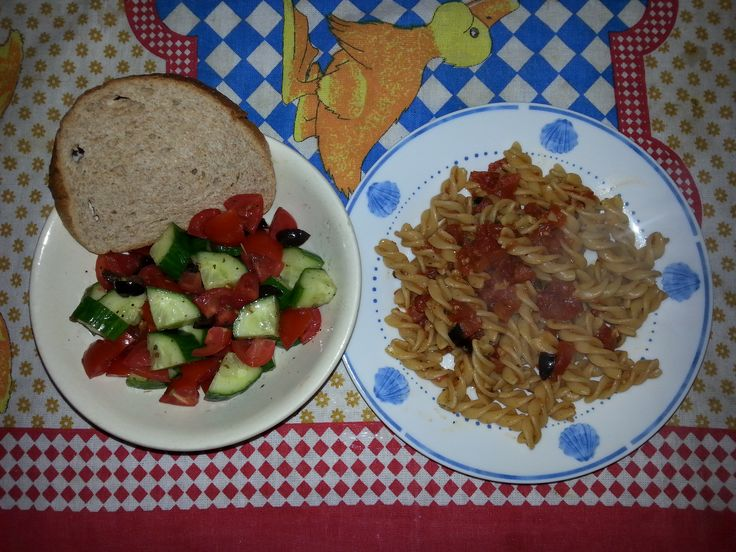 pasta with tomato and black olives ... salad with tomatoes, cucumber ...