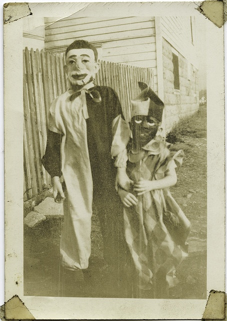Days gone by... Children cleverly decked out for trick-or-treating. (I like how big brother has gently taken hold of the little one's arm.) I hope they had a spooktacular night! <> (vintage, photo, All Hallow's Eve)