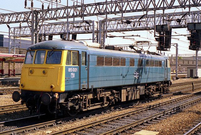 85021 (E3076) light engine at Crewe on the 6th August 1988. E3076 was built at Doncaster Works, and entered service on the 20th April 1963. The loco became 85021 in Oct 1973 and was renumbered again during July 1989 to 85106. On the 15th Oct 1990 85106 caught fire, whilst hauling the 4M58 Southampton-Trafford Park Freightliner, near Soho, Birmingham, and was withdrawn on the 24th Oct as a result. The loco was cut-up at M.C. Metals, Glasgow, during Sept 1992.