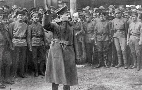 Leon Trotsky, Commander of the Red Army, speaking to his troops in order to maintain morale during the Russian Civil War, 1917-1922. Description from photosofwar.net. I searched for this on bing.com/images